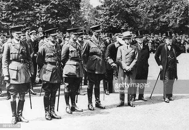 Winston Churchill First Lord of the Admiralty seen here with Prime Minister Herbert Asquith and four unnamed Brigadier Generals at a military parade...