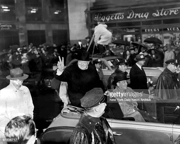 Winston Churchill gives the Victory sign during welcoming parade for the British wartime leader on Broadway