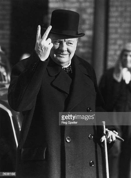 Winston Churchill giving the 'V for Victory' salute