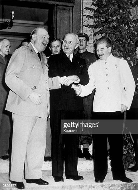Winston Churchill Harry S Truman and Joseph Stalin shake hands during the meeting of 'The Big Three' in Potsdam Original Publication People Disc...