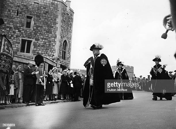 Winston Churchill in robes in a procession at the Garter Awards ceremony