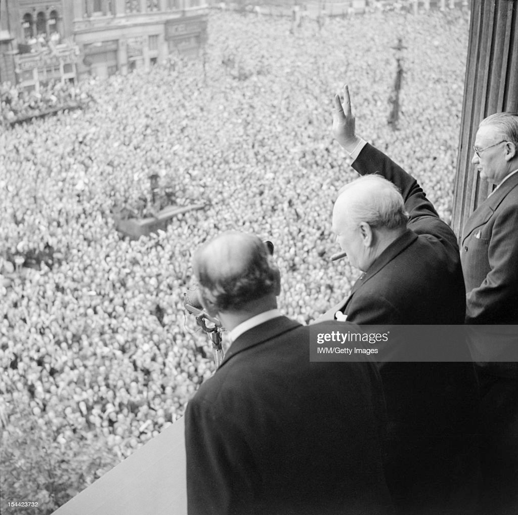 Winston Churchill In The Second World War, Churchill waves to crowds in Whitehall on the day he broadcast to the nation that the war with Germany had been won, 8 May 1945 (VE Day).