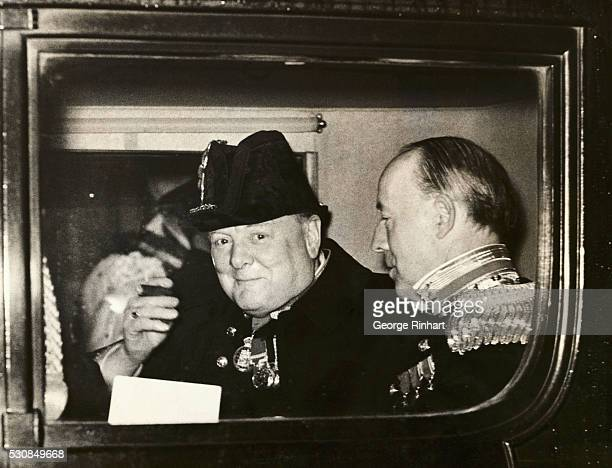 Winston Churchill leaves a reception for King Carol of Romanian and Crown Prince Romanian at the Guildhall in London.