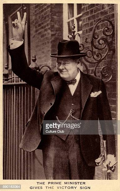 Winston Churchill portrait of the British politician and Prime Minister making the victory gesture / V sign outside of 10 Downing Street in 5 June...