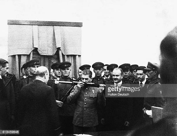 Winston Churchill presents Stalin with a sword of honor for the Russian defence of Stalingrad at the Tehran Conference
