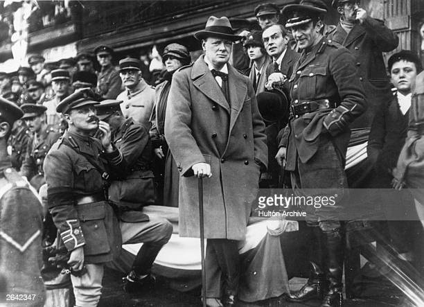Winston Churchill , Secretary of State for War, watching the March Past of the 47th Division from the grandstand in the Grande Place at Lille.