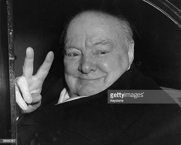 Winston Churchill the Conservative prime minister gives the Vsign as he leaves No 10 Downing Street London for the last time