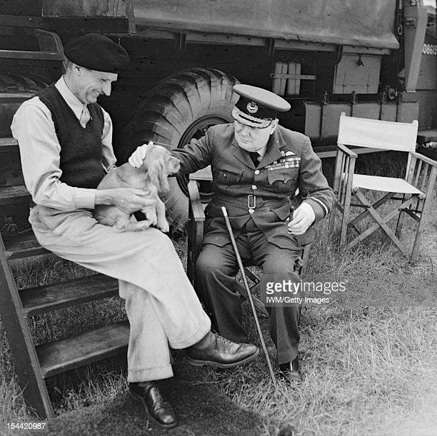 Winston Churchill Visits Normandy August 1944 Prime Minister Winston Churchill and General Sir Bernard Montgomery his dog in Normandy at Montgomery's...