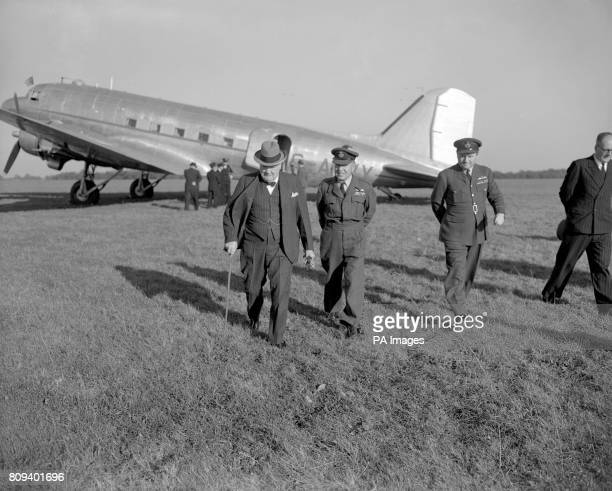 Winston Churchill walks away from his aircraft at Biggin Hill airfield after arriving from a holiday in France