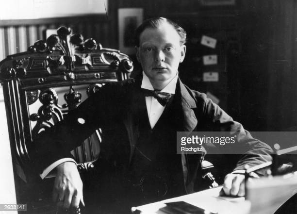 Winston Churchill when MP for Oldham seated at his desk