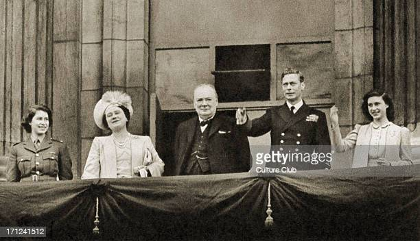 Winston Churchill with Princess Elizabeth, Queen Elizabeth, King George VI, and Princess Margaret, waving from the balcony of Buckingham Palace on...