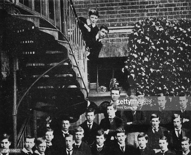 Winston climbing a staircase while the class pose' Winston Churchill and friend stand on a staircase during a class photograph at Harrow From Winston...