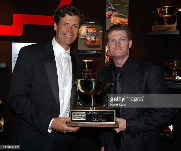 Winston Cup driver Michael Waltrip poses with DEI teammate Dale Earnhardt Jrand the 2003 Chevrolet Manufacturer's Championship trophy