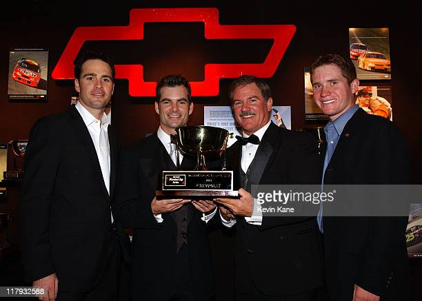 Winston Cup drivers and Hendrick Motorsports teamates pose with the 2003 Chevrolet Manufacturer's Championship trophy Jimmie Johnson Jeff Gordon...