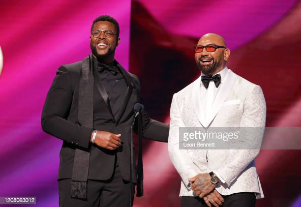 Winston Duke and Dave Bautista speak onstage during the 51st NAACP Image Awards Presented by BET at Pasadena Civic Auditorium on February 22 2020 in...