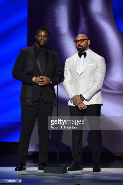 Winston Duke and Dave Bautista speaks onstage during the 51st NAACP Image Awards, Presented by BET, at Pasadena Civic Auditorium on February 22, 2020...