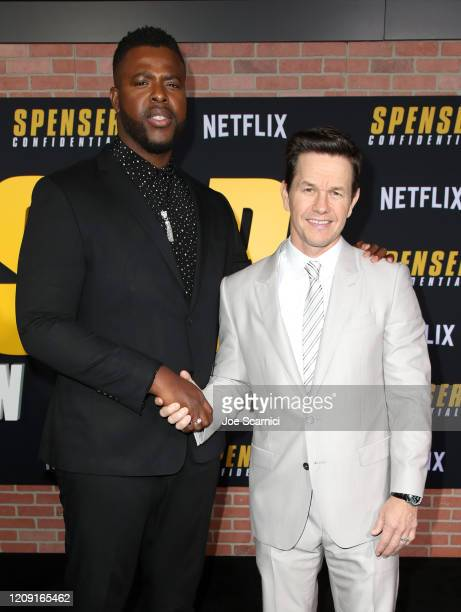 Winston Duke and Mark Wahlberg attend the Netflix Premiere Spenser Confidential at Westwood Village Theatre on February 27, 2020 in Westwood,...