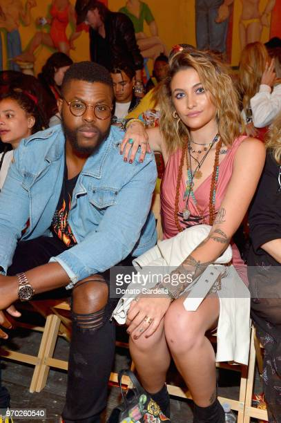Winston Duke and Paris Jackson attend the Moschino Spring/Summer 19 Menswear and Women's Resort Collection at Los Angeles Equestrian Center on June 8...