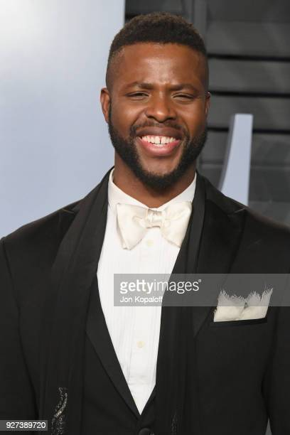 Winston Duke attends the 2018 Vanity Fair Oscar Party hosted by Radhika Jones at Wallis Annenberg Center for the Performing Arts on March 4 2018 in...