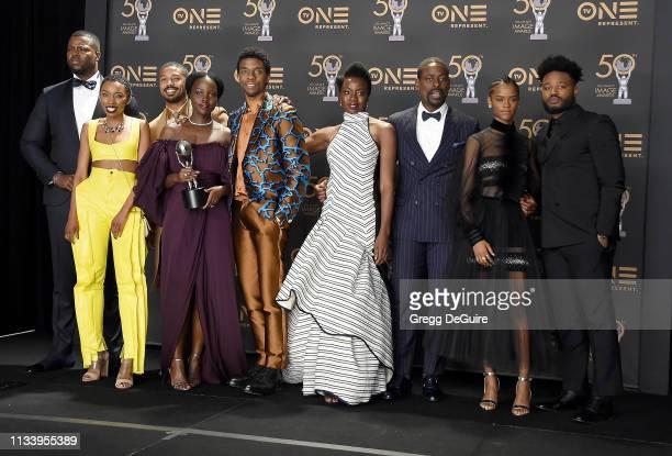 Winston Duke Carrie Bernans Michael B Jordan Lupita Nyong'o Chadwick Boseman Danai Gurira Sterling K Brown Letitia Wright and Ryan Coogler pose in...