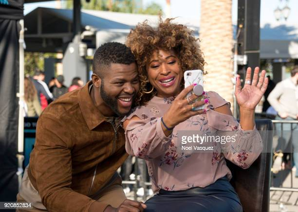 Winston Duke takes a selfie with Tanika Ray at 'Extra' at Universal Studios Hollywood on February 19 2018 in Universal City California