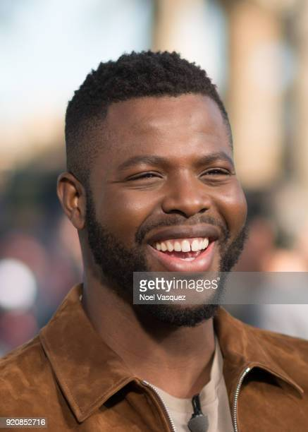 Winston Duke visits 'Extra' at Universal Studios Hollywood on February 19 2018 in Universal City California