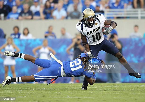 Winston Guy of the Kentucky Wildcats tackles Alex Allen of the Akron Zips during the game at Commonwealth Stadium on September 18 2010 in Lexington...