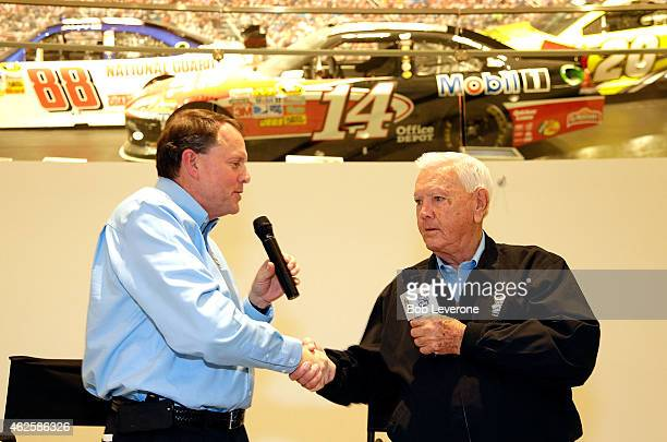 Winston Kelley execuive director of the NASCAR Hall of Fame welcomes Hall of Fame driver Junior Johnson during NASCAR's Fan Appreciation Day at the...