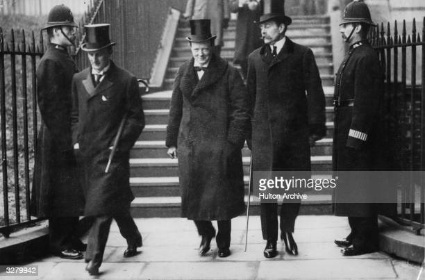 Winston Leonard Spencer Churchill , British Statesman and Prime Minister, as Home secretary being accompanied to a Cabinet Meeting by Sir Edward Grey...