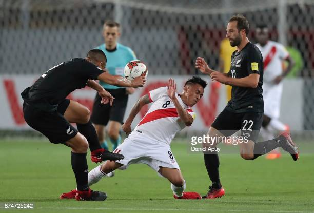 Winston Reid and Andrew Durante of New Zealand fight for the ball with Christian Cueva during a second leg match between Peru and New Zealand as part...