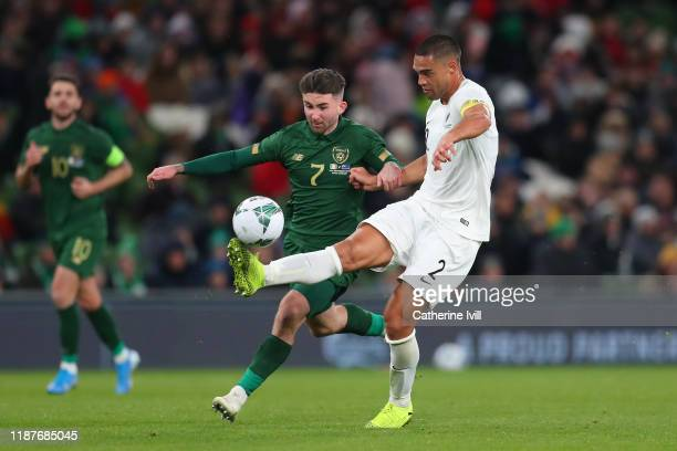 Winston Reid of New Zealand controls the ball under pressure from Sean Maguire of Republic of Ireland during the International Friendly match between...