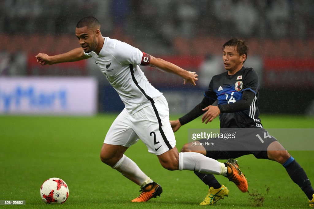 Winston Reid of New Zealand controls the ball under pressure of Takashi Inui of Japan during the international friendly match between Japan and New Zealand at Toyota Stadium on October 6, 2017 in Toyota, Aichi, Japan.