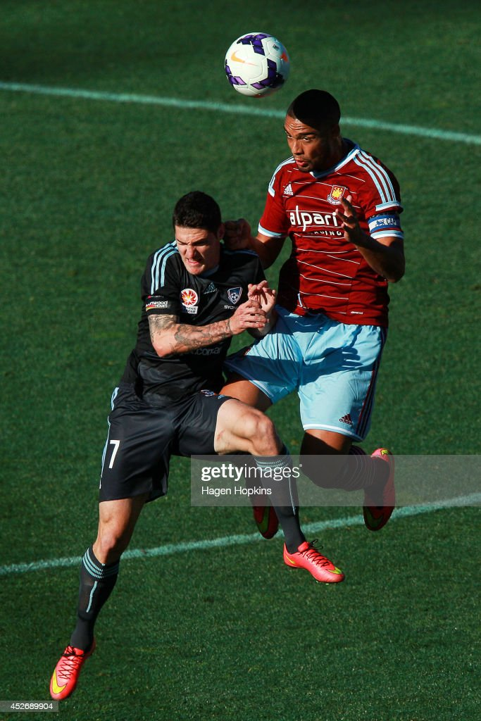 Winston Reid of West Ham United and Corey Gameiro of Sydney FC compete for a header during the Football United New Zealand Tour 2014 match between Sydney FC and West Ham United at Westpac Stadium on July 26, 2014 in Wellington, New Zealand.