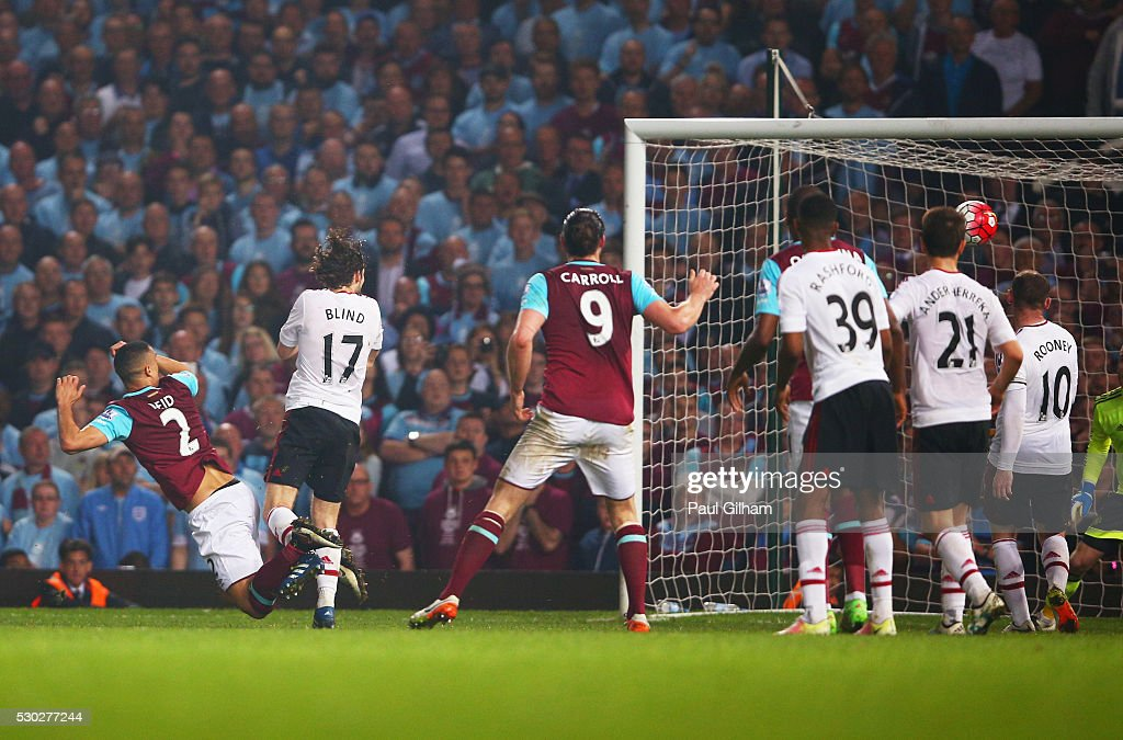 Winston Reid of West Ham United (2) beats Daley Blind of Manchester United to score their third goal during the Barclays Premier League match between West Ham United and Manchester United at the Boleyn Ground on May 10, 2016 in London, England. West Ham United are playing their last ever home match at the Boleyn Ground after their 112 year stay at the stadium. The Hammers will move to the Olympic Stadium for the 2016-17 season.