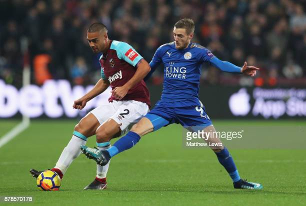Winston Reid of West Ham United beats Jamie Vardy of Leicester City to the ball during the Premier League match between West Ham United and Leicester...