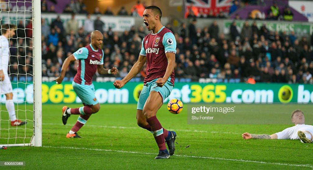 Winston Reid of West Ham United celebrates scoring his team's second goal with a header during the Premier League match between Swansea City and West Ham United at Liberty Stadium on December 26, 2016 in Swansea, Wales.