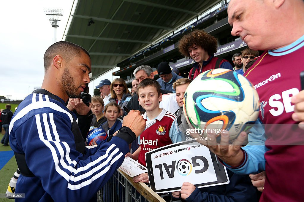 Winston Reid signs autographs during a West Ham United training session at North Harbour Stadium on July 20, 2014 in Auckland, New Zealand.