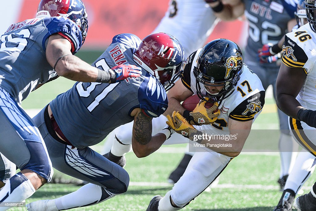 Winston Venable #31 of the Montreal Alouettes tackles Luke Tasker #17 of the Hamilton Tiger-Cats during the CFL game at Percival Molson Stadium on September 7, 2014 in Montreal, Quebec, Canada. The Alouettes defeat the Tiger-Cats 38-31.