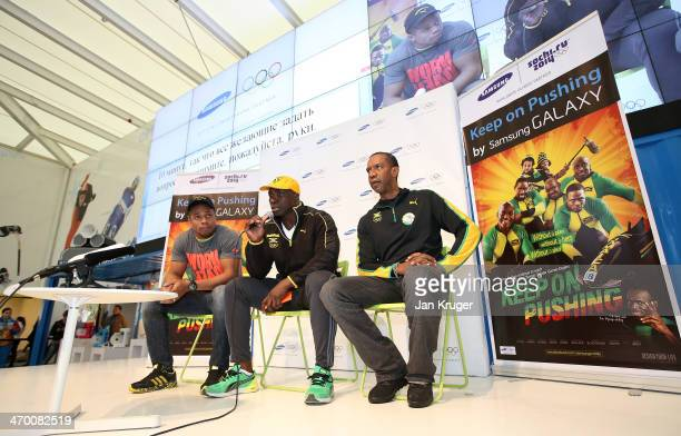 Winston Watts and Marvin Dixon Jamaica's 2man bobsleigh team and Jamaican Bobsleigh Federation President Chris Stokes address fans and media at a...