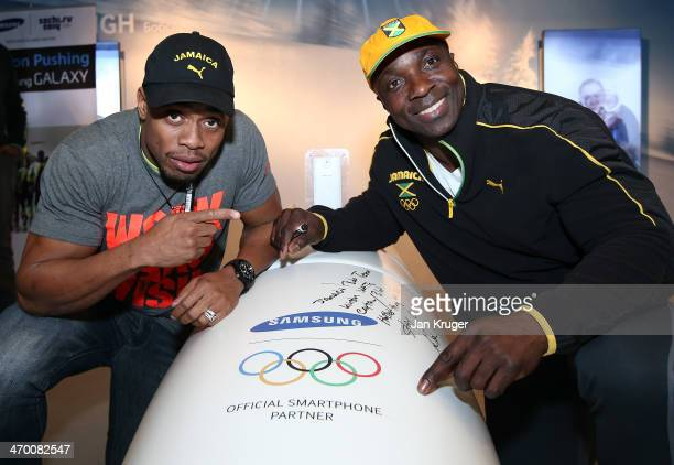Winston Watts and Marvin Dixon Jamaica's 2man bobsleigh team pose with the Samsung bobsleigh at the Galaxy Studio during the Sochi 2014 Winter...