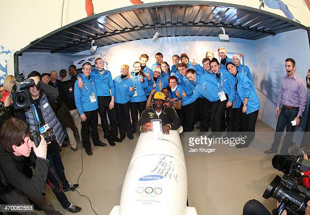 Winston Watts and Marvin Dixon Jamaica's 2man bobsleigh team pose with the Samsung bobsleigh and staff at the Samsung Galaxy Studio during the Sochi...