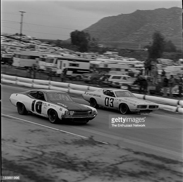 Winston Western 500 The Ford Torino of Bill Champion goes sidebyside with Chuck Bown in a Charger