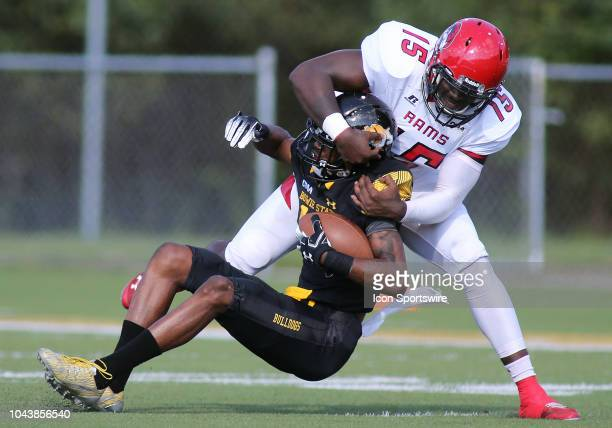 WinstonSalem State University linebacker Patrick Green takes down Bowie State University wide receiver Lansana Sesay during a match between Bowie...