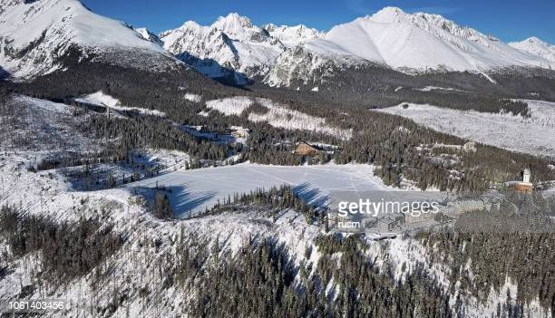winter aerial of strbske pleso lake resort in high tatras mountains, slovakia - slovakia stock pictures, royalty-free photos & images