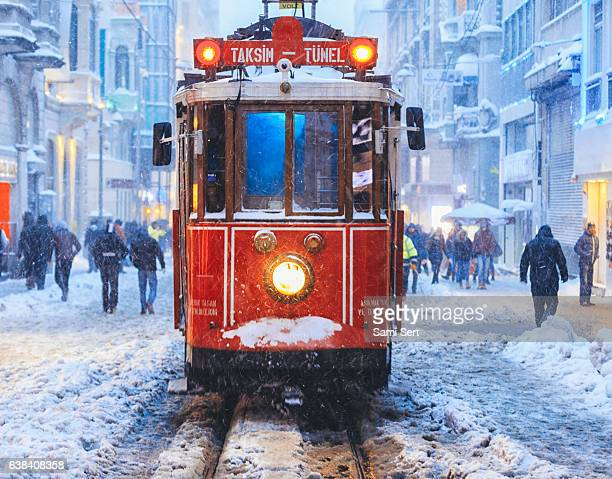 Winter and Red Tram in Istiklal Street, Beyoglu, Istanbul.