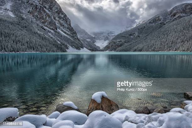 winter at lake louise - chateau lake louise stock photos and pictures