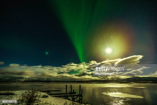 winter: aurora borealis, spectacular northern lights with moon rise in swedish lapland - swedish lapland stock photos and pictures
