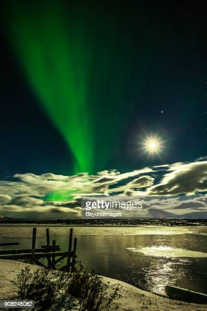 winter: aurora borealis, spectacular northern lights with moon rise in swedish lapland - norrbotten province stock pictures, royalty-free photos & images