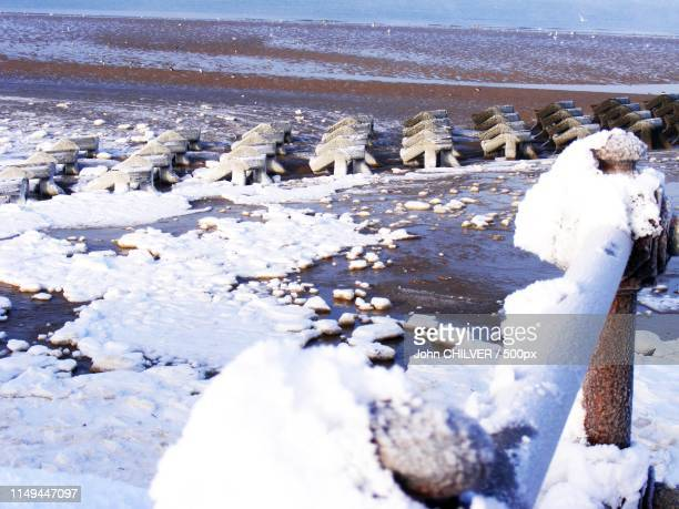 winter beach - northern rail stock pictures, royalty-free photos & images