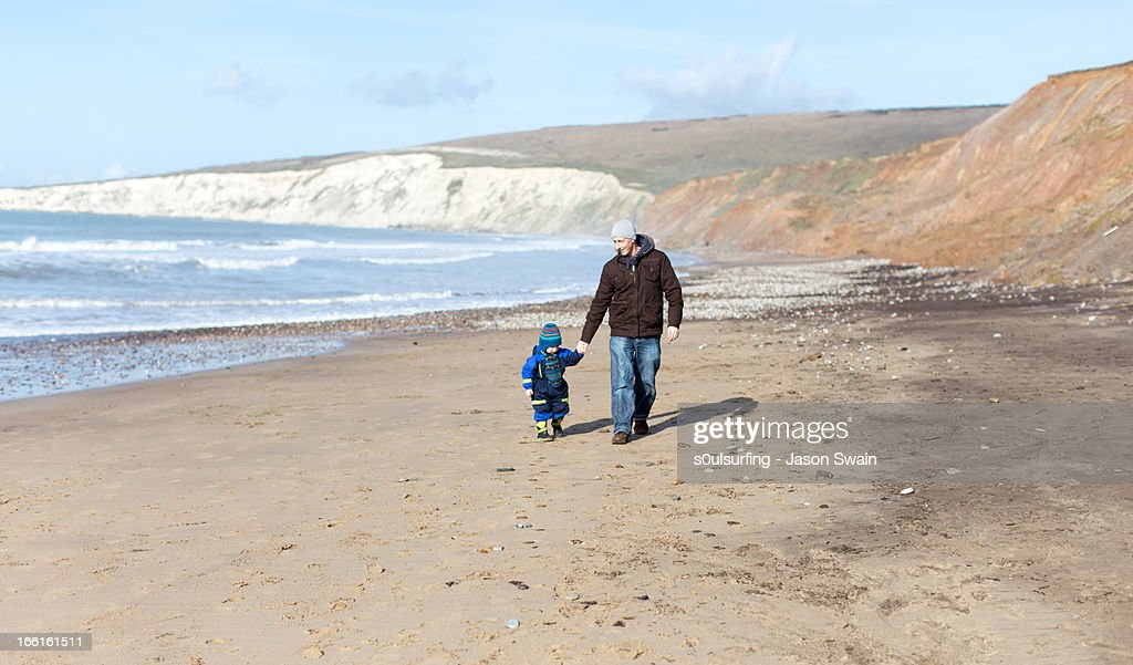 Winter Beach Walk with Dad : Stock Photo